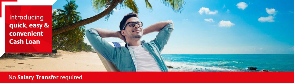 Young man relaxing on beach after acquiring a RAKBANK Cash Loan